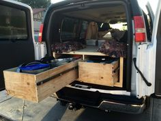 Storage Drawers for van using skate board roller bearings to support heavy loads, yet roll out with ease.