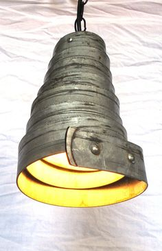 A unique light fixture hand made from old wine barrel rings!