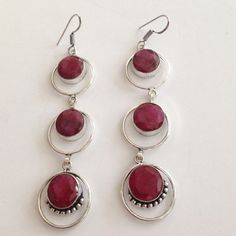 💯% 925 Sterling Silver cherry Ruby Earrings 💞🎀 Price Drop-Gorgeous 💞 Faceted, hand crafted Deep colored, 💯%  Cherry Ruby, 3 tiered earrings, encased in 💯% 925 Sterling silver and circled with silver as well. Bottom gem stones have soldered circle details to give a vintage flair, beautifully hand made💕 with French hook fasteners. Earrings measure 3.5 X 0.8 inches in length X's Width. High quality, unique beauties🎀💞💕NWOT Hand crafted/made Jewelry Earrings