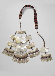 Philippines ~ Ifugao | Pectoral worn by both men and women of the Isneg people from Cagayan valley | Shell, agate beads, silver, pearls and pineapple fiber | These are only worn during important ceremonies and are handed down through the generations.