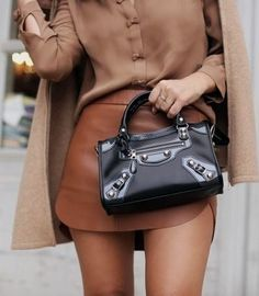 I really like monochromatic outfits - this would be great for work. I also like the mixed textures of leather and silk.