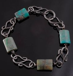 just this image - link is broken - beautiful way to incorporate beads on wire with chain-links