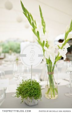 White & silver table number & greens | Photography: Michelle van Heerden Photography, Flowers & Décor: Marguerite van Aardt, Stationery: Moonbeams and Polkadots