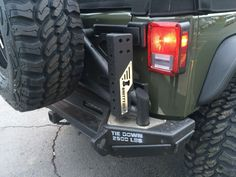 2016 #Jeep Wrangler Unlimited passenger side rear view of #smittybilt rear bumper and tire carrier