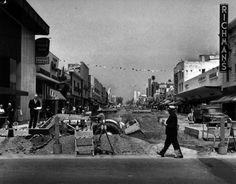 In 1965, workers tore up Third Street's asphalt roadway to create the three-block Santa Monica Mall. 'A pedestrian's paradise in the making' is how the Herald captioned this photograph. Courtesy of the Herald-Examiner Collection - Los Angeles Public Library.