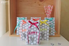 Create beautiful embellishments for birthday gift bags using our cute Thinlits dies, designed by Craft Asylum.