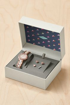 The gift that everyone loves? A  rose gold watch and jewelry set with glitz.