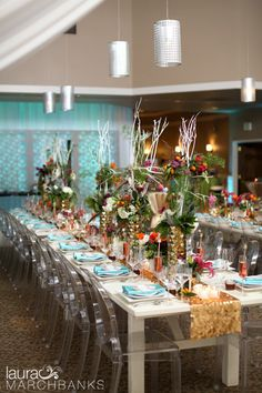 Long rectangular tables by Farm Tables with ghost chairs from ABC Rentals. Orange, turquoise, hot pink, gold wedding reception with florals by Florressence, catering by Lisa Dupar, dessert by The People's Cake, paper by Merchant's Designs.  Weddings in Woodinville photographer Laura Marchbanks captures geometric wedding details at Columbia Winery designed and coordinated by Simply Wed. Laura Marchbanks Seattle Wedding Photography.