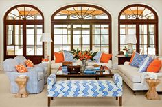 Living Room - Beach House Beauty - Southernliving. Seating shouldn't be limited to club chairs and sofas. Utilize benches, ottomans, and odd side chairs to accommodate more people.
