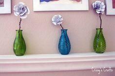Recycleren: Blikjes worden originele bloemen http://blog.huisjetuintjeboompje.be/recycleren-blikjes-worden-originele-bloemen/