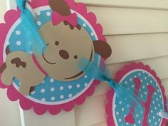 "Puppy Birthday Banner with pink and turquoise polka dot.     All orders are custom made and shipped the week before your event.    If you would like another color combination just let me know and I will be happy to create a custom order for you.    Listed below are the options:    $15.00 ~ Name banner includes first name only ( up to 10 letters) puppies are included.  If your child's name is longer please email me for a special order.    $25.00 ~ Birthday banner includes ""Happy Birthday""…"