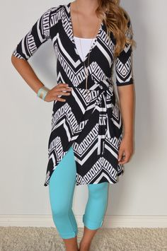 Add a pop of color to this bold graphic wrap dress!