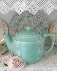 My teapot is in the same shade of robin's egg blue. It rests on the white mantle in the morning room. My plate is white but echoes the blue in sprigs of flowers.