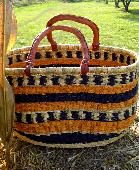 Shopper Basket  The Shopper Basket is our second most popular style.  This basket is slender in profile & easy to carry.  10-14 inches in height, oval with 2 handles.  The green alternative to a grocery bag