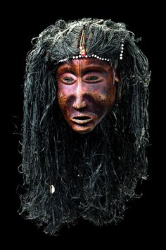 Africa | Mask from the Luena people of Angola | Wood, pigment, plant fiber and glass beads