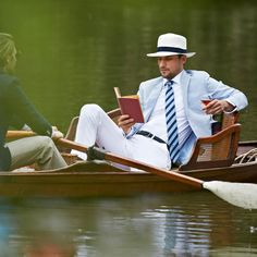 I love that look - stubble beard, white shirt and pants, striped tie, light blue jacket and panama hat.