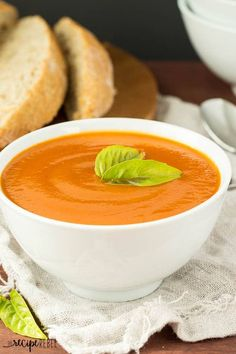 Tomatoes and vegetables simmer all day in the slow cooker, then they're pureed to make this creamy tomato soup that is secretly loaded with veggies!