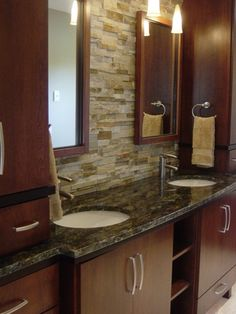 The stone veneer on the wall warms up the often cold feel of granite on the countertops.