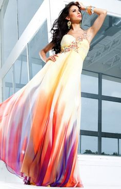 Get colorful and bright in this amazing Tony Bowls TBE11229 evening Prom dress!  The fabulous Yellow colors compliment darker skin tones and really make the other colors pop! The ruched bust area accentuates the waist for a thin, long look.  This dress features a beautiful one shoulder strap that is embellished with lovely multi-colored beading and rhinestones!  The bottom of this dress is the best part!  The yellow slowly fades into lovely hues of pink, orange, and purple. The cutout…