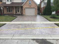 Grand Ashlar Slate Stamped Concrete Driveway with Rough Cut Border in Woodstock Ontario Stamped Concrete Driveway, Concrete Driveways, Driveway Ideas, Rough Cut, Woodstock, Slate, Ontario, Sidewalk, Decor