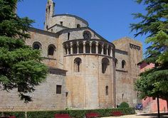 The Cathedral of Santa Maria d'Urgell, Spain, has an apsidal east end projecting at a lower level to the choir and decorated with an arcade below the roofline. This form is usual in Italy and Germany.