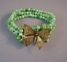 HASKELL Hess green glass bead and gold tone butterfly