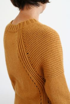 Sigma is a cozy and stylish sweater which is fun to knit and to wear. It features feminine neckline, elongated raglan line and combination of different textures.The sweater is worked seamlessly top-down in one piece.