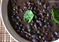 A bowl of creamy, rich Cuban black beans is the mark of a good Cuban restaurant, and now you can make them at home. This recipe includes stovetop and slow cooker versions.