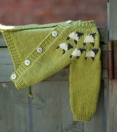 Welcome To the Flock - knitted baby sweater - photo from Yarn Harlot's blog. super cute sheep and love the green color!
