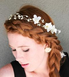 Ivory Woodland Wedding Wreath by BE Something New. Set this sweet woodland wreath around your head, and you're ready for any nuptials that might come along your way (planned ones, that is). The wedding wreath is made of ivory berries, a few flowers and ivory ribbons to tie it all up at the back. $34.00 @scoutmob