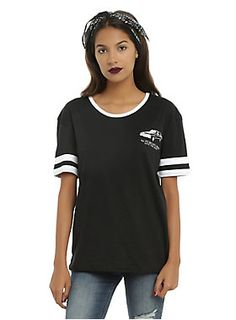 """Black tee from <i>Supernatural</i> with an Impala logo design on the left chest, white trim collar and white striped sleeves. Join the hunt, girl!<br><ul><li style=""""LIST-STYLE-POSITION: outside !important; LIST-STYLE-TYPE: disc !important"""">50% cotton; 50% polyester</li><li style=""""LIST-STYLE-POSITION: outside !important; LIST-STYLE-TYPE: disc !important"""">Wash cold; dry low</li><li style=""""LIST-STYLE-POSITION: outside !important; LIST-STYLE-TYPE: disc !important"""">Imported</li><li…"""