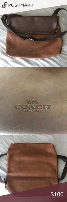 COACH cross body bag COACH cross body in smooth leather.  Soft bag with contrasting colors and nice leather.  Gently worn and in excellent condition. Small pen mark on leather on underside of flap. Coach Bags Messenger Bags