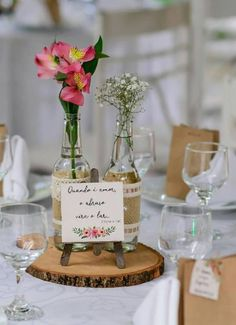 Love love the piece of wood underneath & I like the mini easel too. Maybe do different size bottles/candle holders/vases too. Wedding Party Favors, Wedding Centerpieces, Wedding Table, Diy Wedding, Rustic Wedding, Wedding Decorations, Wedding Day, Wedding Colors, Wedding Flowers