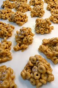 Cheerio Treats    • 1 c. sugar  • 1 c. corn syrup  • 1 c. creamy peanut butter  • 1 t. vanilla  • 5 c. Cheerios (I used Honey Nut Cheerios)    In a large sauce pan, combine sugar and corn syrup. Bring to boil over medium heat.    Allow mixture to boil for one minute and remove from heat.    Add peanut butter and vanilla to mixture and mix