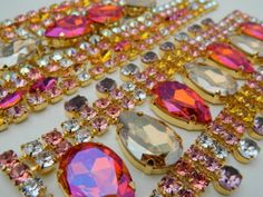 "Jewels for the Imperial Ball, ballet, opera, or really, just for FUN!!  Features multiple floral tones in Swarovski crystal and features their new exlusive colour ""Astral Pink"" in the feature stones.  Absolutely stunning... like the corona of the sun at sunset in summer!"
