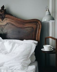 Gorgeous wooden headboard. Pretty bedroom details.