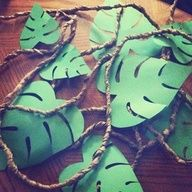 "Cute cut paper leaves could be cute on the ""vines""... Does green look too ""rainforest"", though?"