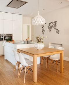 Modern apartment located in Spain, designed in 2017 by Natalia Zubizarreta Interiorismo. Open Plan Kitchen Living Room, Home Decor Kitchen, Kitchen Furniture, Kitchen Interior, Home Kitchens, Kitchen Island Dining Table, Simple Dining Table, Pastel Living Room, Kitchen Cabinet Design