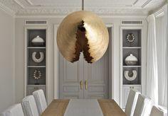 MODERN DINING ROOM |  a modern dining room decor, where the brass lighting is the statement piece, Design Aleksandra Miecznicka | www.bocadolobo.com #diningroomdecorideas #moderndiningrooms