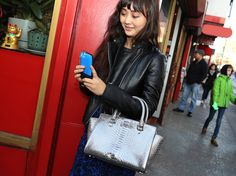 Connie Wang, Style Director at Refinery 29, in Michael Kors Holiday Collection carrying our latest tech-cessory. New York, December 2014