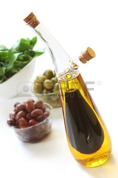 Bottle Of Olive Oil And Balsamic Vinegar With Olives And Green Salad In The  Background Stock