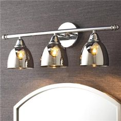 """Chrome Translucent Glass Vanity Light - 3 LightChrome Translucent Glass Vanity Light - 3 Light Chrome translucent glass shades add a unique quality to this modern bath light. The glass becomes a diffuser and cuts down on the glare of the lamp. The simple style keeps attention on the distinctive glass shades. 3-60 watt medium base lamp required. (8""""Hx23""""Wx8""""D) 5"""" diameter backplate."""