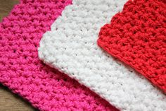 These handmade cotton washcloths / dishcloths will add a bright and cheery pop of color to your home. They are made with a soft textured crochet stitch thats perfect for scrubbing dishes, but soft enough for cleaning your face. These are made with cheery colored yarns in pink, red, and white.  This listing is for a set of 3 cloths. If you would like a larger set instead, please send me a message. Im happy to accommodate custom requests!  The 5th listing picture shows available options - ...