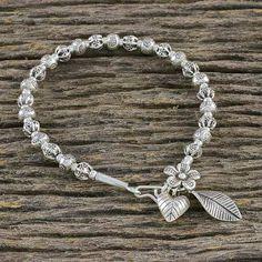 Silver beaded charm bracelet, 'Bead Bouquet' - Thai Floral 950 Silver Hill Tribe Beaded Charm Bracelet