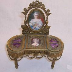 Miniature French Dore Bronze Vanity Vitrine, 1880 ~ with two miniature portraits on ivory, lavender enamel inserts, double beveled mirror and all original silk lining in drawers and boxes.