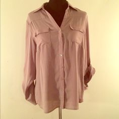 Large Tan Blouse Perfect For the Office Large Tan Blouse Perfect For the Office. Rolled sleeve accents perfect for all seasons. Lightly worn. New York & Company Tops Button Down Shirts