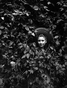 Amélie Galup in foliage, 1897 by Marie Galup