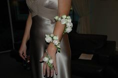 Calypso Flowers: pale creamy-pink mini-roses for a wedding.     They were bound onto a wire covered in an offcut of fabric     from the bride's dress. These corsages definitely need about 5 days'     notice to get the ingredients together