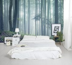 Moody, misty and marvellous. This forest wallpaper makes a stunning feature wall in the bedroom.