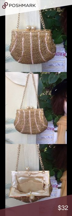 """VTG MR ERNEST SIMON BEADED HANDBAG Pretty little Evening beaded bag....its done in gold beads with egg shape faux pearls has beautiful filigree balls as the closure and heavy curb link chain handle,the frame is a gold metal and its lined in an Ivory satin little light staining not a big deal no tears or rips,it's by Mr Ernest Simon all handmade in Hong Kong! It measures 6.5"""" x 5"""" handle is 6.5"""" long this is a weighty bag for its size!!! It's in EUC!!! Vtg Mr Ernest Simon Bags Mini Bags"""